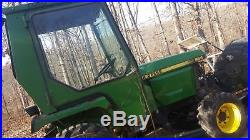 Curtis cozy cab john deere 955 with heat, wipers, lights etc. And jd Snow plow