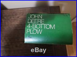 Ertl John Deere plow in ice cream box with insert. New, never played with