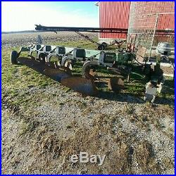 John Deere 2800 5-bottom variable width plow. Spring reset