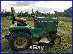 John Deere 318 tractor with snow plow, box blade