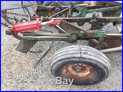 three plow type Jd pull bottom