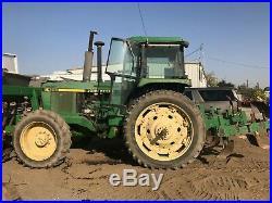 John Deere 4255 Row Crop Tractor/Rear Shank Plow and front fertilizer hopper