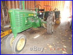 John Deere B with potato picker and 2 bottom plow