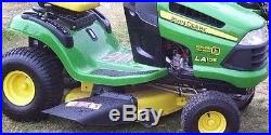 John Deere LA105 Lawn Tractor 19.5hp 42 withsnow plow & grass catcher attachments