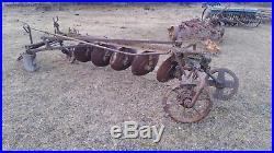 John Deere Steel wheel disk plow
