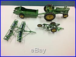 VTG JOHN DEERE TOY TRACTOR MODEL A with disc harrow, 2 btm plow & manure spreader