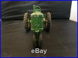 Vintage Ertl John Deere 620 with 4 row mount plow 1/16 scale